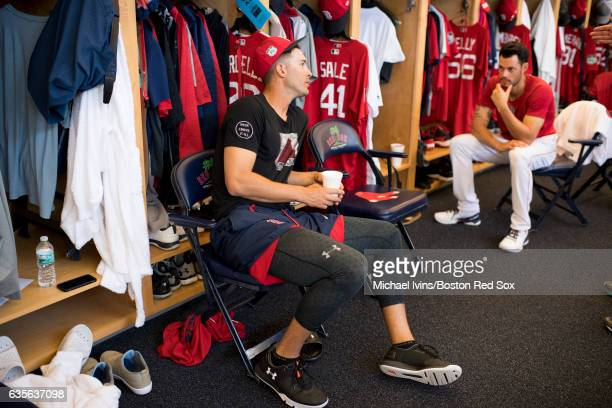 Rick Porcello of the Boston Red Sox talks with Joe Kelly in the clubhouse on February 16 2017 at jetBlue Park in Fort Myers Florida