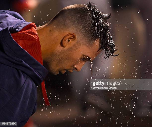 Rick Porcello of the Boston Red Sox throws water on his head after the eighth inning of the game against the Los Angeles Angels at Angel Stadium of...