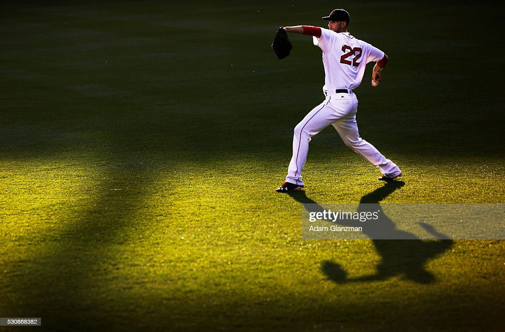 Rick Porcello #22 of the Boston Red Sox warms up in center field before the game against the Oakland Athletics at Fenway Park on May 11, 2016 in Boston, Massachusetts.