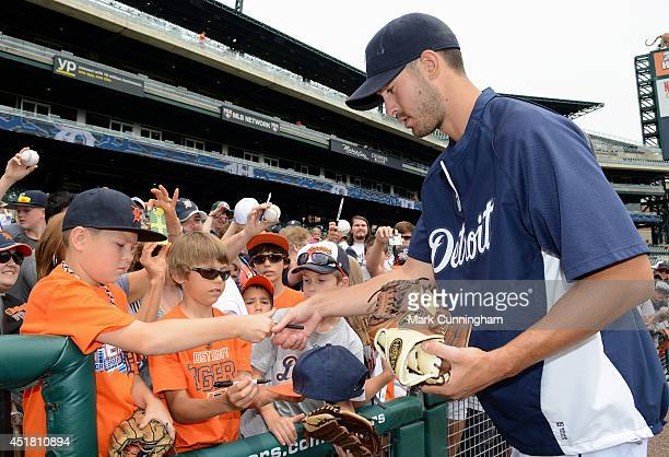 Rick Porcello of the Detroit Tigers signs autographs for fans prior to the game against the Tampa Bay Rays at Comerica Park on July 5 2014 in Detroit...