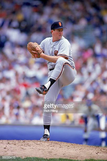 Rick Reuschel of the San Francisco Giants winds up for a pitch during a game against the Chicago Cubs circa 1987-1991 at Wrigley Field in Chicago,...