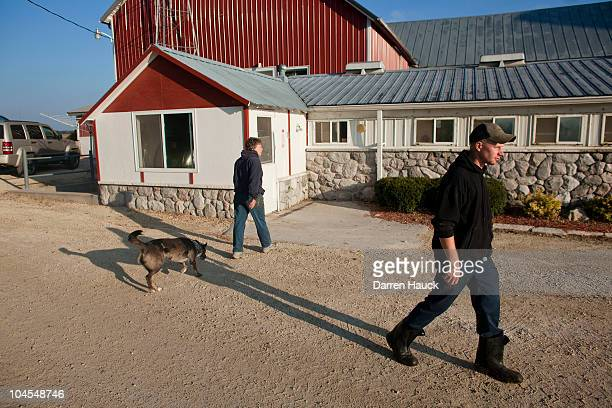 Rick Roden continues on after talking with his mother Cindy Roden at the the RobNCin farm on September 29 2010 in West Bend Wisconsin The farm has...