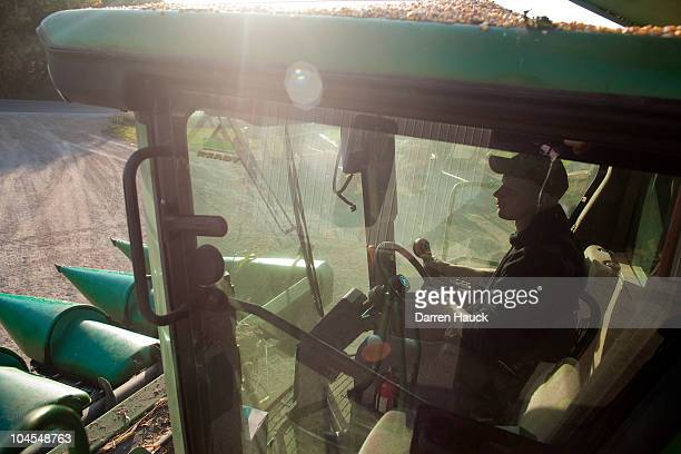 Rick Roden drives a tractor at the RobNCin farm on September 29 2010 in West Bend Wisconsin The farm has roughly 400 head of cattle and about 1800...