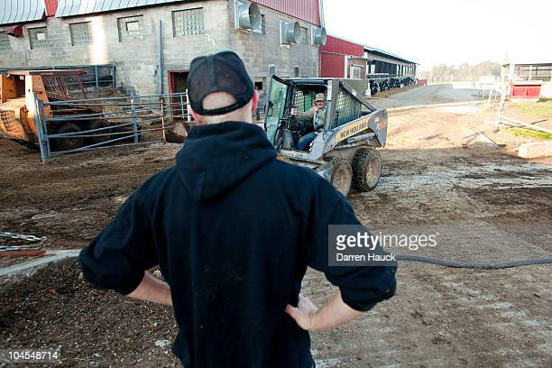 Rick Roden receives instructions from his father Robert Roden at the RobNCin farm on September 29 2010 in West Bend Wisconsin The farm has roughly...