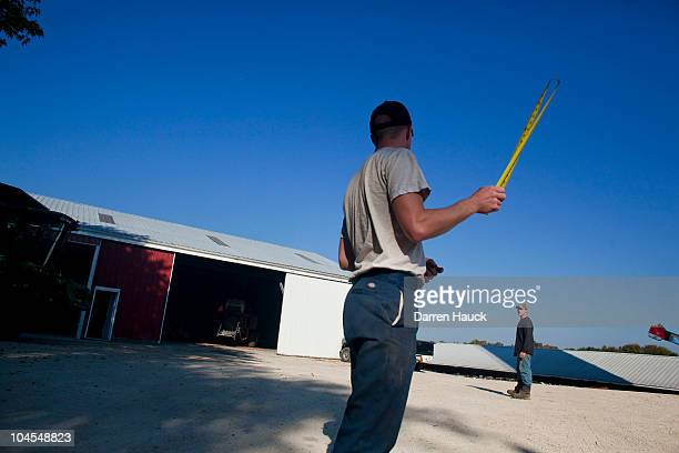 Rick Roden talks with his cousin Jerad Herther at the RobNCin farm on September 29 2010 in West Bend Wisconsin The farm has roughly 400 head of...