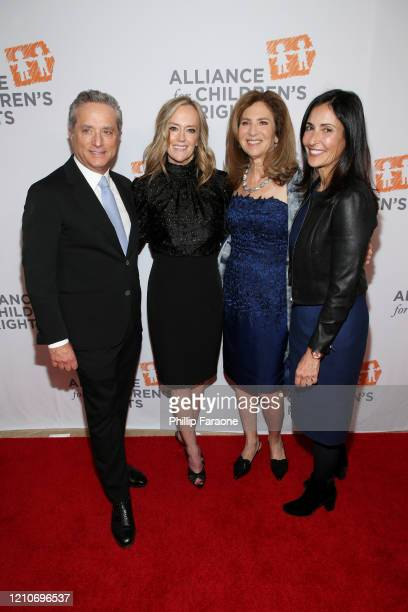 Rick Rosen Karey Burke Susan Saltz and Leslie GilbertLurie attend The Alliance For Children's Rights 28th Annual Dinner at The Beverly Hilton Hotel...