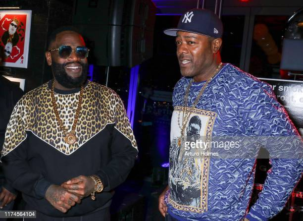 Rick Ross and Damion DRoc Butler celebrates the Biggie Inspires Art Exhibit Celebration at William Vale Hotel on September 13 2019 in New York City