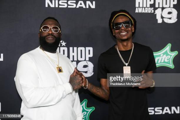 Rick Ross and DJ Sam Sneak arrives to the 2019 BET Hip Hop Awards on October 05 2019 in Atlanta Georgia