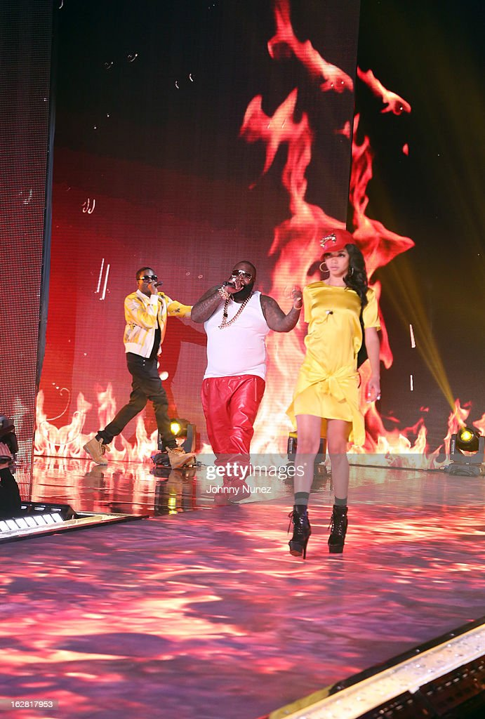 Rick Ross (c) and Meek Mill (L) perform during BET's Rip The Runway 2013 at Hammerstein Ballroom on February 27, 2013, in New York City.