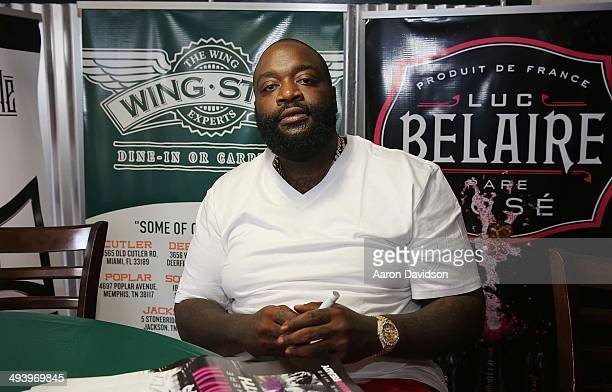 Rick Ross meets and greets fans at Wing Stop on May 26 2014 in Deerfield Beach Florida