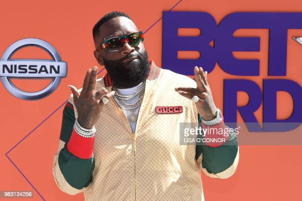 Rick Ross poses upon arrival for the BET Awards at Microsoft Theatre in Los Angeles California on June 24 2018