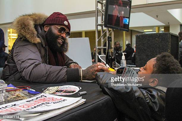Rick Ross signing cd's at DTLR South Dekalb Mall on November 28 2014 in Atlanta Georgia
