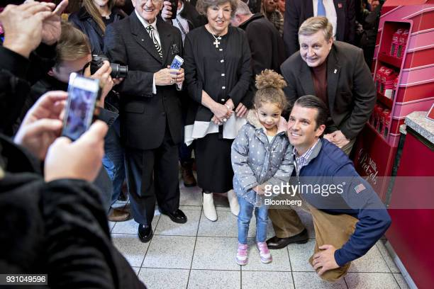 Rick Saccone Republican candidate for the US House of Representatives top right and Donald Trump Jr executive vice president of development and...