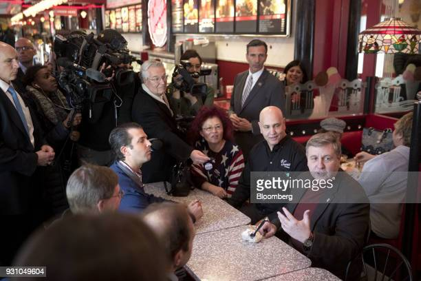 Rick Saccone Republican candidate for the US House of Representatives bottom right speaks to members of the media with Donald Trump Jr executive vice...