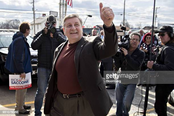 Rick Saccone Republican candidate for the US House of Representatives gives a thumbsup during a campaign event with volunteers and service members at...