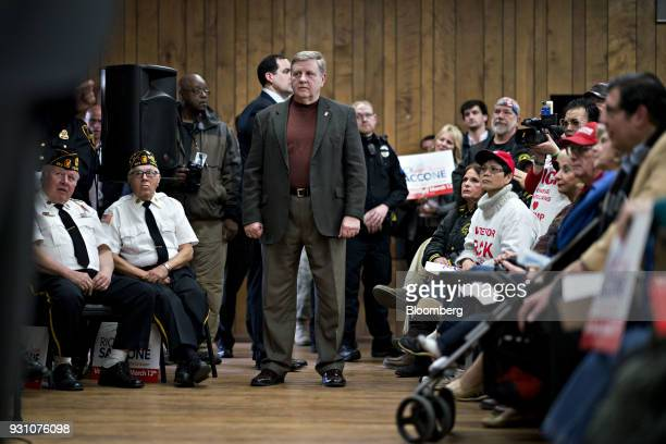 Rick Saccone Republican candidate for the US House of Representatives center listens as Donald Trump Jr executive vice president of development and...