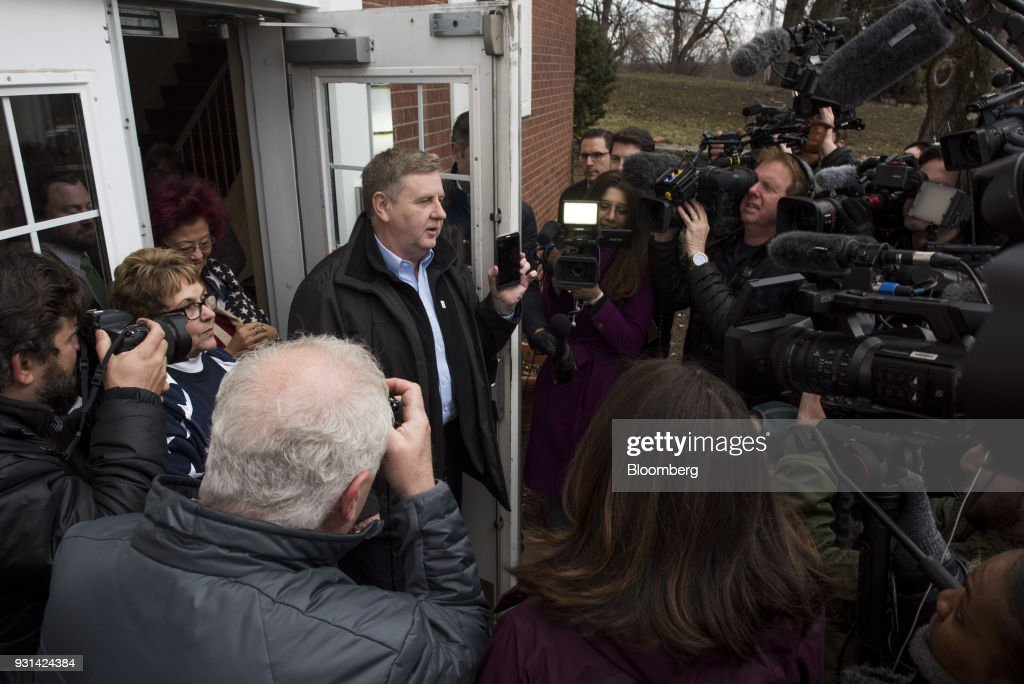 Rick Saccone, Republican candidate for the U.S. House of Representatives, holds a smartphone while speaking to members of the media after voting at the Mount Vernon Presbyterian Church polling location in McKeesport, Pennsylvania, U.S., on March 13, 2018. Saccone and Democrat Conor Lamb are competing in the 18th District, where President Donald Trump won by almost 20 points in the 2016 presidential election, to replace Republican Tim Murphy who resigned last October amid personal scandal. Photographer: Ty Wright/Bloomberg via Getty Images