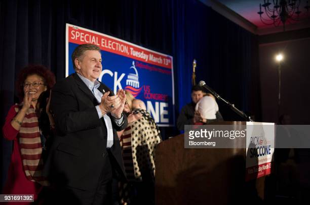 Rick Saccone Republican candidate for the US House of Representatives applauds during an election night rally in Elizabeth Township Pennsylvania US...