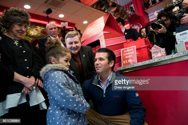 Rick Saccone Republican Congressional candidate for Pennsylvania's 18th district and Donald Trump Jr greet a young girl during a tour of Sarris...