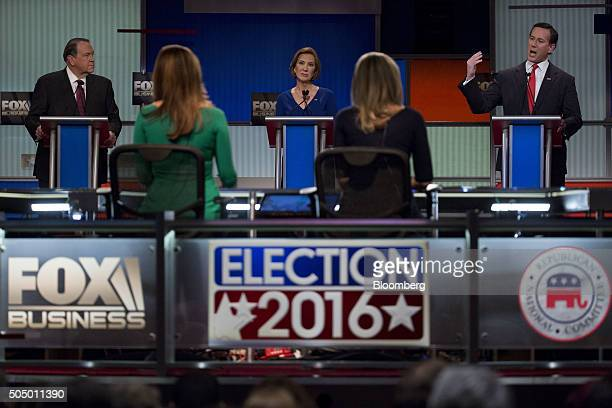 Rick Santorum former senator from Pennsylvania and 2016 Republican presidential candidate right speaks as Carly Fiorina former chairman and chief...