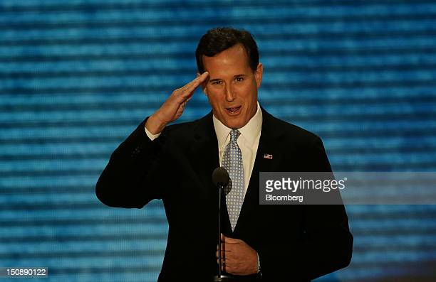 Rick Santorum former US Senator salutes while speaking at the Republican National Convention in Tampa Florida US on Tuesday Aug 28 2012 Delegates are...