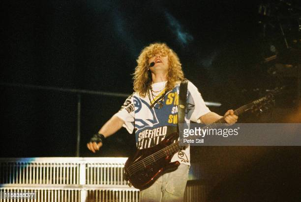 Rick Savaage of Def Leppard performs on stage at The Don Valley Stadium, on June 6th, 1993 in Sheffield, England.
