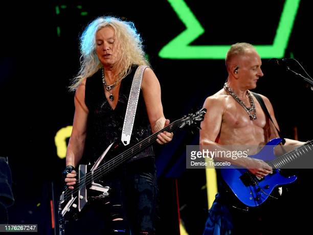 Rick Savage and Phil Collen of Def Leppard perform onstage during the 2019 iHeartRadio Music Festival at TMobile Arena on September 21 2019 in Las...
