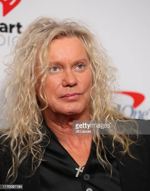 Rick Savage of Def Leppard attends the 2019 iHeartRadio Music Festival at TMobile Arena on September 21 2019 in Las Vegas Nevada