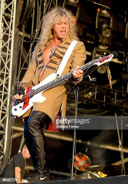 Rick Savage of Def Leppard performs headlining the main stage at day three of the Download Festival at Donington Park on June 14 2009 in Castle...