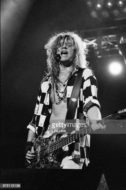 Rick Savage of Def Leppard performs on August 03, 1993 in Allentown, Pennsylvania.