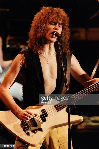 Rick Savage of Def Leppard performs on stage at Hammersmith Odeon, on December 5th, 1983 in London, England.