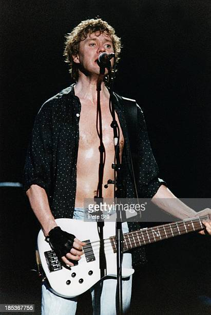 Rick Savage of Def Leppard performs on stage at the Birmingham NEC, on October 16th, 1996 in Birmingham, England.