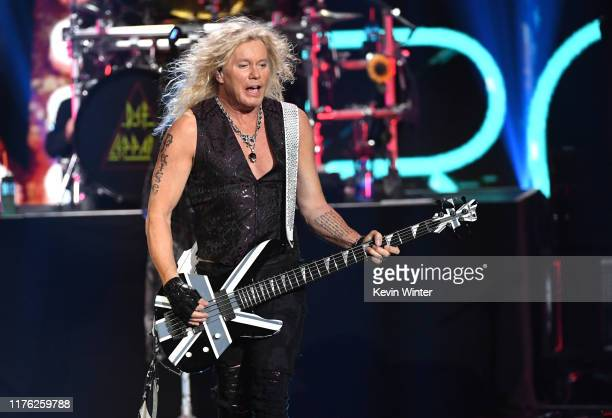 Rick Savage of Def Leppard performs onstage during the 2019 iHeartRadio Music Festival at T-Mobile Arena on September 21, 2019 in Las Vegas, Nevada.