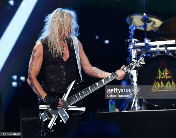 Rick Savage of Def Leppard performs onstage during the 2019 iHeartRadio Music Festival at TMobile Arena on September 21 2019 in Las Vegas Nevada