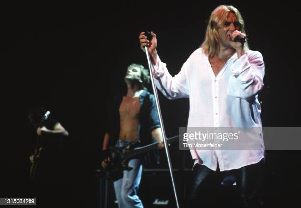 Rick Savage, Phil Collen, and Joe Elliott of Def Leppard perform at Shoreline Amphitheatre on August 31, 1996 in Mountain View, California.