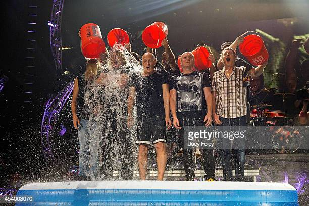 Rick SavageJoe ElliottVivian CampbellPhil Collenand Rick Allen of the band Def Leppard participate in the ALS Ice Bucket Challenge at Klipsch Music...