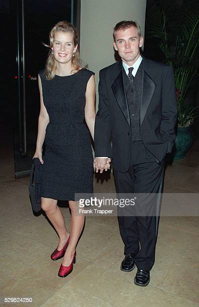 Rick Schroder arrives with his wife