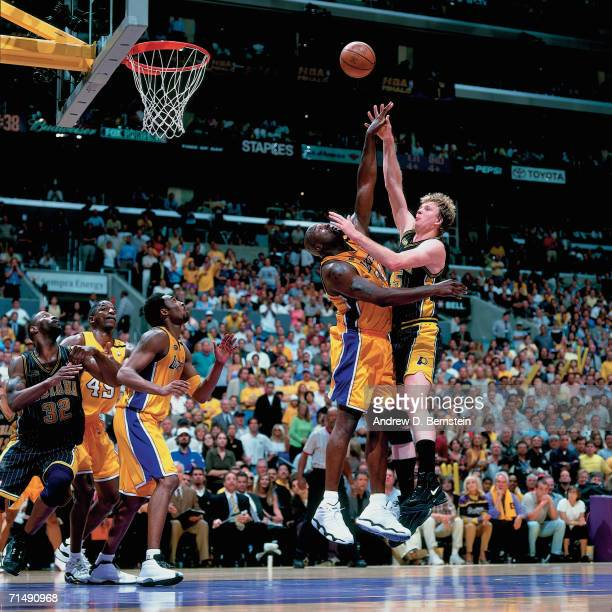 Rick Smits of the Indiana Pacers attempts a shot against Shaquille O'Neal of the Los Angeles Lakers during Game Six of the 2000 NBA Finals on June 19...