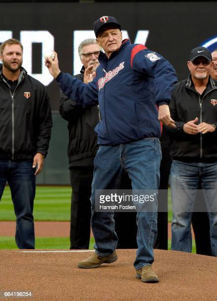 Rick Stelmaszek former coach for the Minnesota Twins delivers the ceremonial first pitch as former players A J Pierzynski Jack Morris and Ron...
