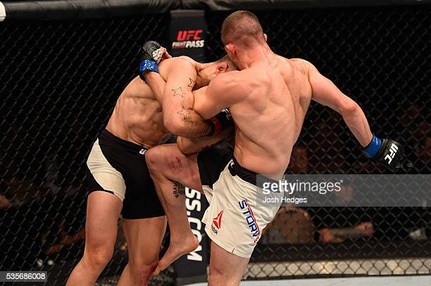 Rick Story knees Tarec Saffiedine of Belgium in their welterweight bout during the UFC Fight Night event inside the Mandalay Bay Events Center on May...