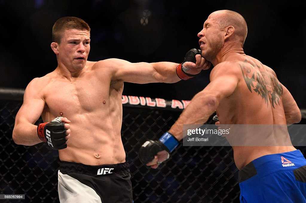 Rick Story punches Donald Cerrone in their welterweight bout during the UFC 202 event at T-Mobile Arena on August 20, 2016 in Las Vegas, Nevada.