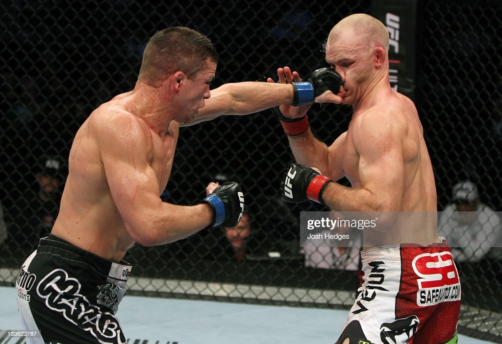 Rick Story punches Martin Kampmann during an UFC Welterweight bout at the HP Pavillion on November 19, 2011 in San Jose, California.