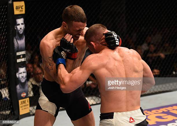Rick Story punches Tarec Saffiedine of Belgium in their welterweight bout during the UFC Fight Night event inside the Mandalay Bay Events Center on...