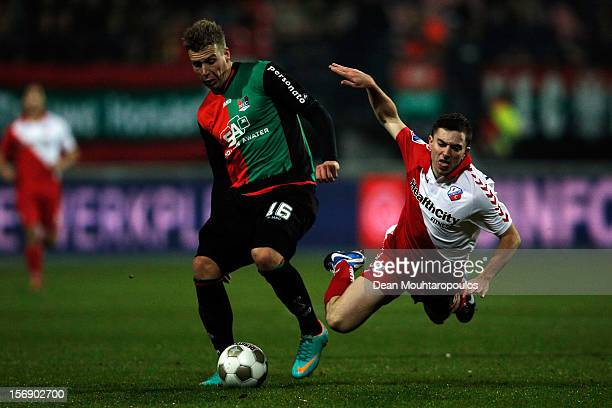 Rick ten Voorde of NEC pushes Tommy Oar of Utrecht off the ball during the Eredivisie match between NEC Nijmegen and FC Utrecht at the McDOS...