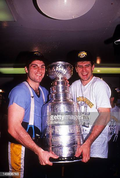 Rick Tocchet and Ron Francis of the Pittsburgh Penguins celebrate in the locker room with the Stanley Cup after Game 4 of the 1992 Stanley Cup Finals...