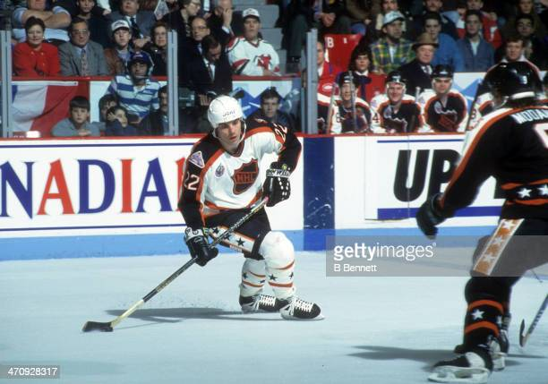Rick Tocchet of the Wales Conference and the Pittsburgh Penguins skates with the puck during the 1993 44th NHL AllStar Game against the Campbell...