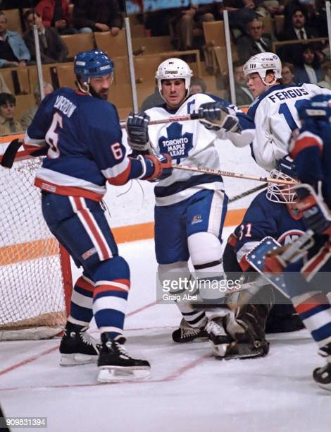 Rick Vaive and Tom Fergus of the Toronto Maple Leafs skate against Ken Morrow of the New York Islanders during game action on November 6 1985 at...