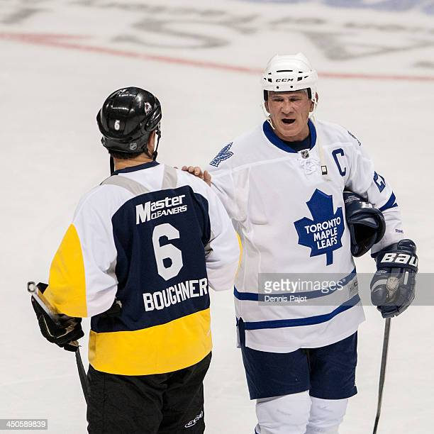 Rick Vaive of the Toronto Maple Leafs Alumni offers a few words to Bob Boughner of the Windsor Spitfires Alumni on November 8 2013 at the WFCU Centre...