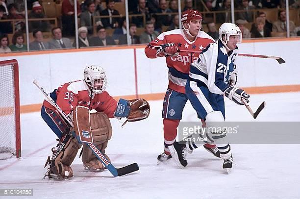 Rick Vaive of the Toronto Maple Leafs battles with Scott Stevens of the Washington Capitals in front of Caps goalie Al Jensen during game action at...