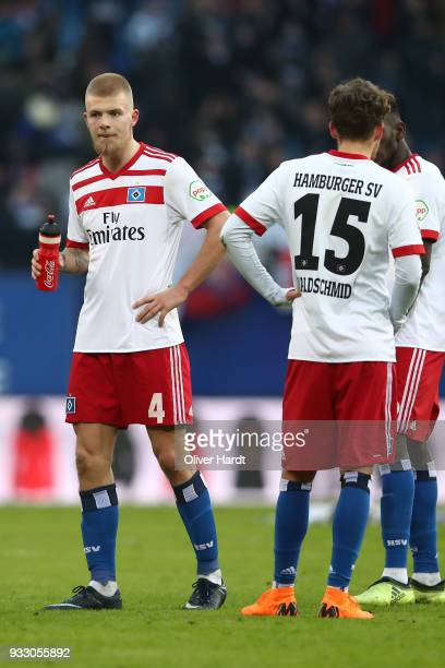 Rick van Drongelen and Luca Waldschmidt of Hamburg appears frustrated after the Bundesliga match between Hamburger SV and Hertha BSC at...
